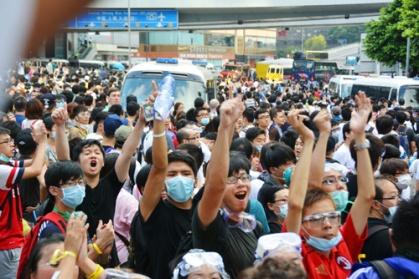 H.K. pro-democracy activists block main road