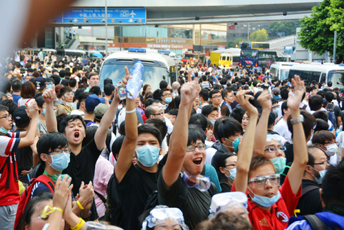 H.K. pro-democracy activists block main road