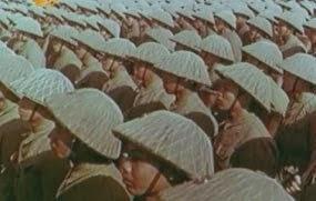 Quân trường Bách Sắc làm lễ mãn khóa tốt nghiệp cho tân sĩ quan. Quân đội Trung Quốc không ngần ngại trang bị quân phục, giả mạo quân đội Cộng Sản Việt Nam. Đoàn quân không số 124 nghìn quân, lên đường qua cửa khẩu hữu nghị, Hồ Chí Minh chính thức cho mở cửa biên giới để quân tình báo Trung Quốc tiến vào Việt Nam. Nguồn: Quân Ủy Trung Ương (CPC).