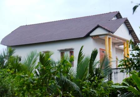 Căn nhà 3 tầng số 465/48C ở khu phố Phước Hậu, phường Long Phước, quận 9 do bà Phạm Thị Thủy, vợ ông Trần Văn Truyền đang đứng tên sở hữu.