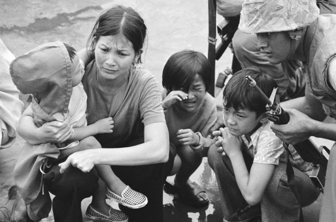 FILE - In this April 29, 1975 file photo, a South Vietnamese mother and her three children are shown on the deck of an amphibious command ship being plucked out of Saigon by U.S. Marine helicopters in Vietnam. The war ended on April 30, 1975, with the fall of Saigon, now known as Ho Chi Minh City, to communist troops from the north. (AP Photo/File)